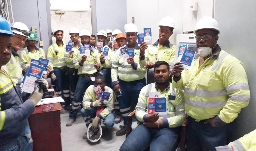 Above and below: Team TGI proudly displaying the Heart Healthy brochure